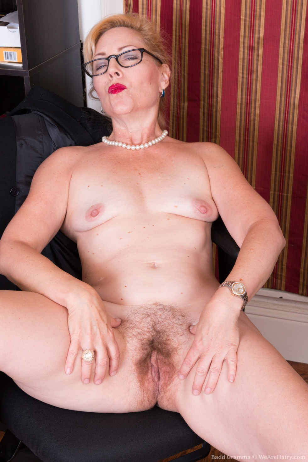 Beautiful mature blonde has her shaved pussy filled with a hook and clit pumped 9