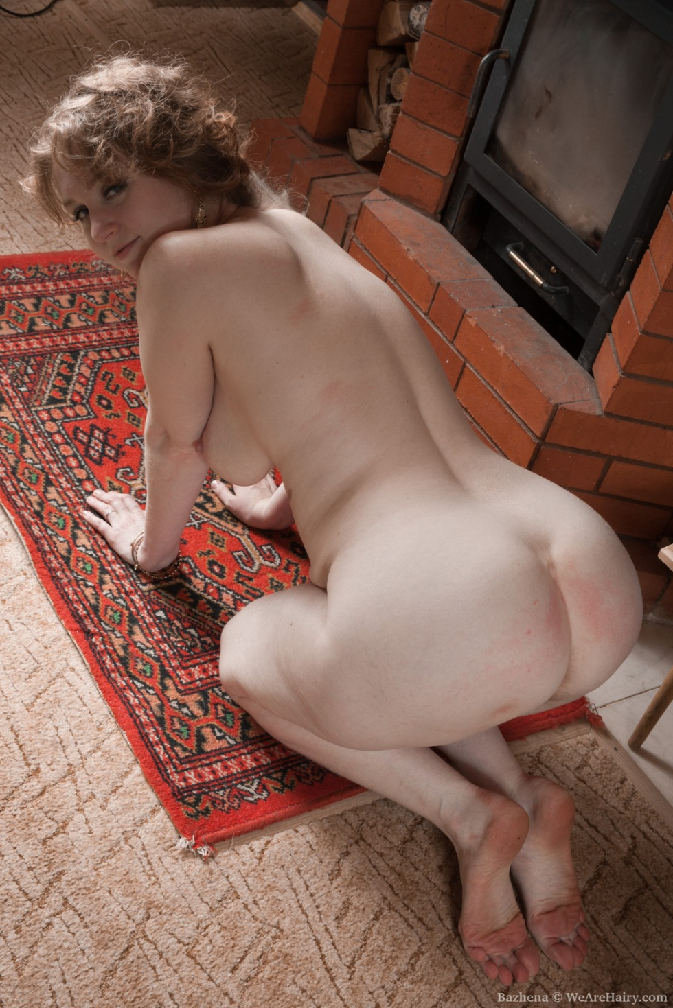 WeAreHairy Bazhena: Bazhena strips naked by her fireplace ...
