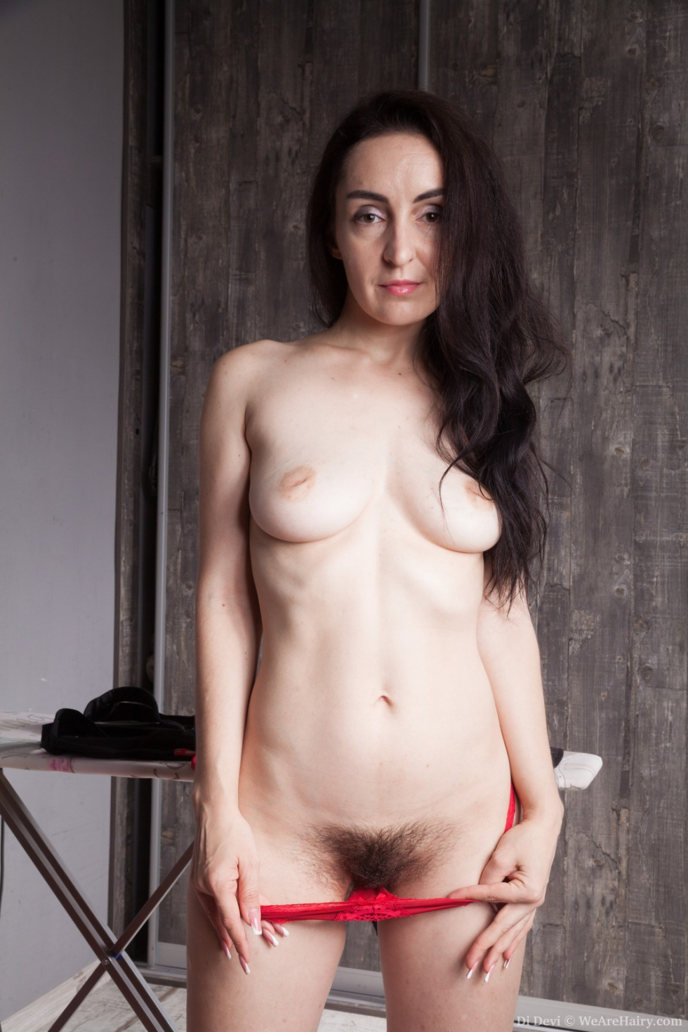 Lavatta w strips naked and sexy in her kitchen 10