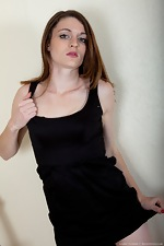 Hairy woman Louise Harmen removes black dress