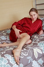 Hairy woman Rachel lounges in bed in a red robe