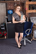 Simona strips naked while in her office today